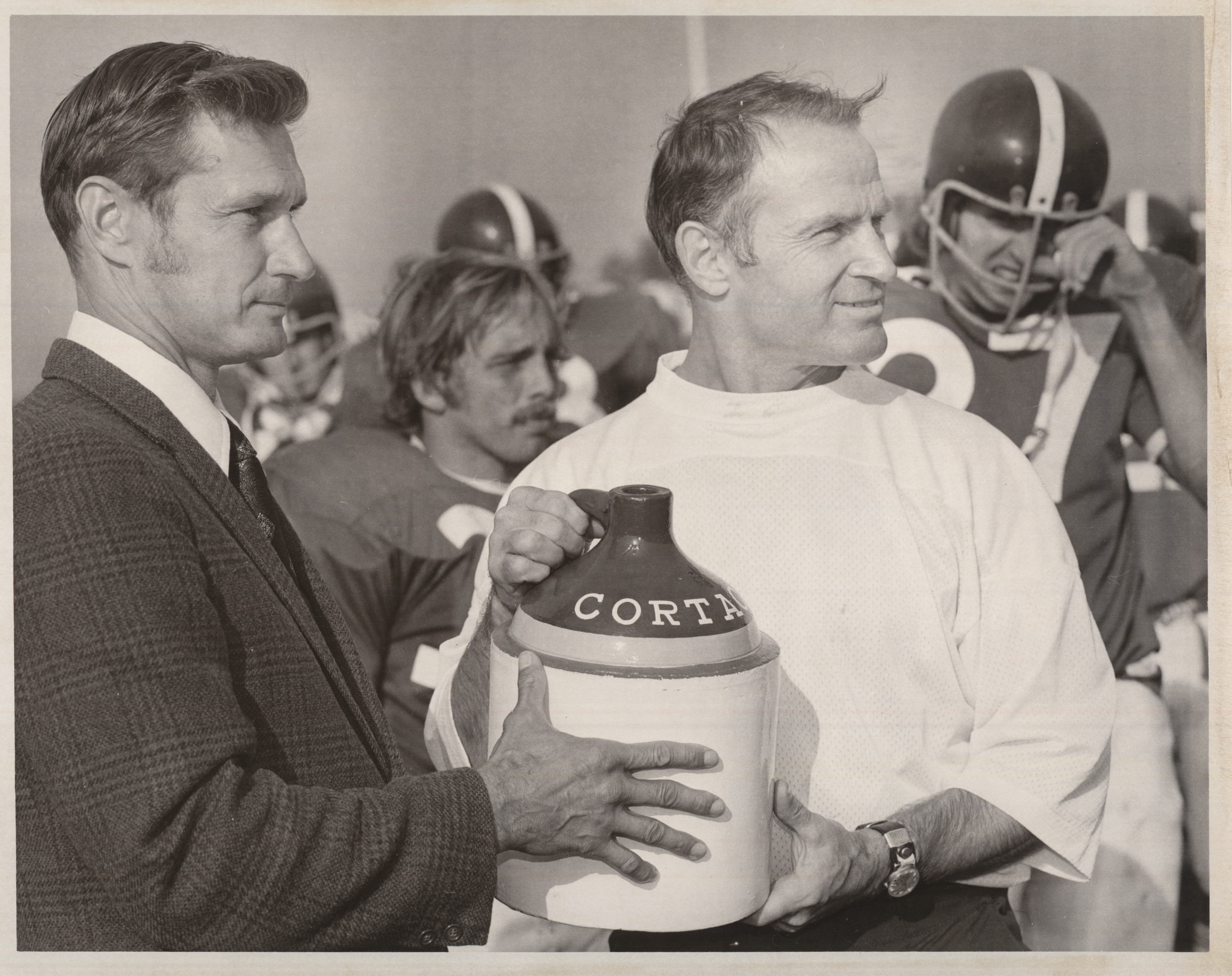 Football coach Jim Butterfield with the Cortaca Jug