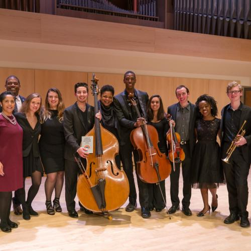 Writers and student musicians pose with President Collado.